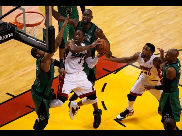 MIAMI, FL - MAY 28:  Rajon Rondo #9 of the Boston Celtics drives in the first half against Mario Chalmers #15 of the Miami Heat in Game One of the Eastern Conference Finals in the 2012 NBA Playoffs on May 28, 2012 at American Airlines Arena in Miami, Florida.  NOTE TO USER: User expressly acknowledges and agrees that, by downloading and or using this photograph, User is consenting to the terms and conditions of the Getty Images License Agreement.  (Photo by Mike Ehrmann/Getty Images)