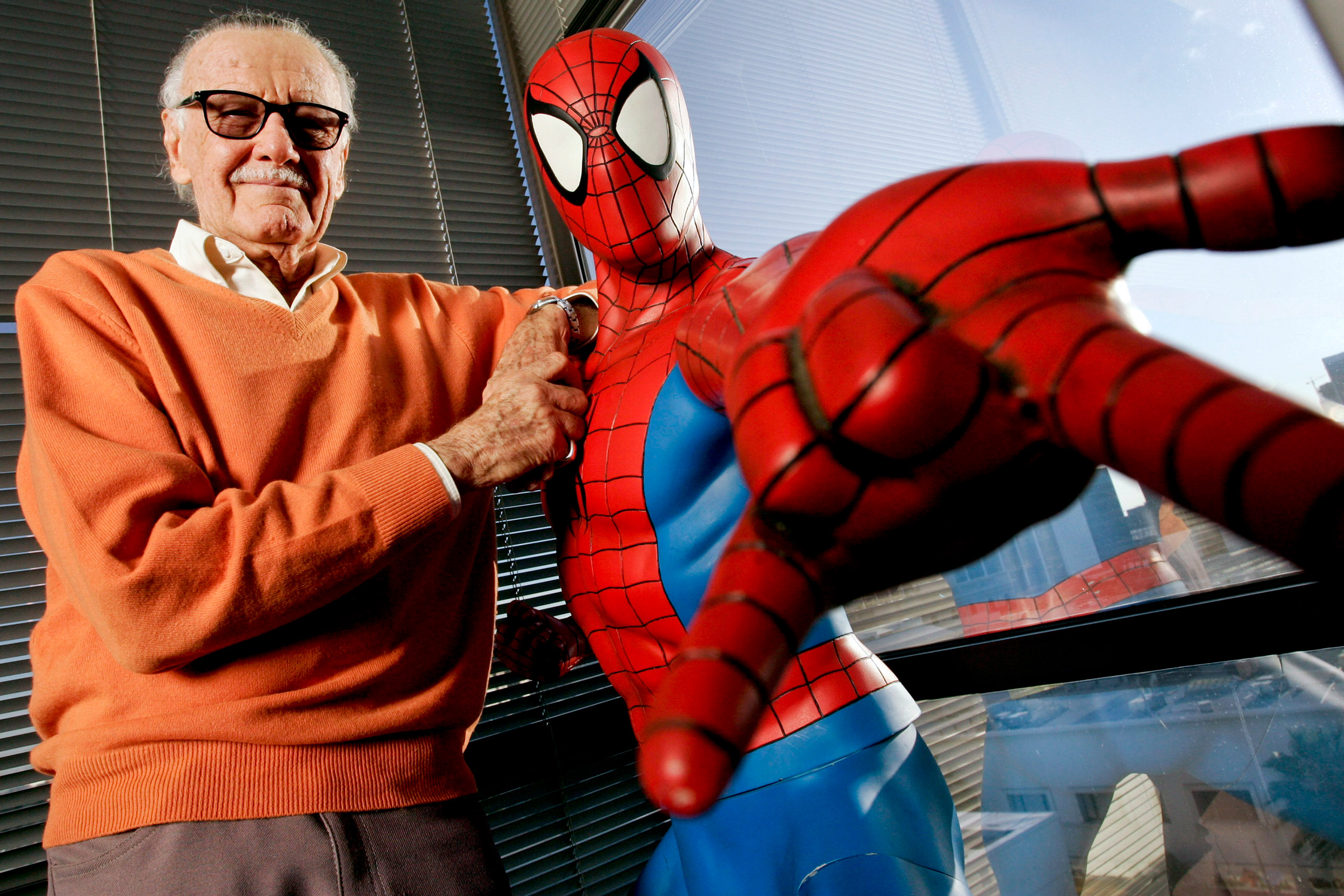 Stan Lee, founder of Marvel Entertainment Inc., poses next t