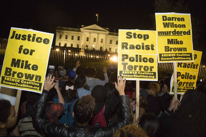 Protesters demonstrate after the decision by a Missouri grand jury not to indict a Ferguson white police officer in the fatal shooting of unarmed black teenager Michael Brown, in front of the White House in Washington