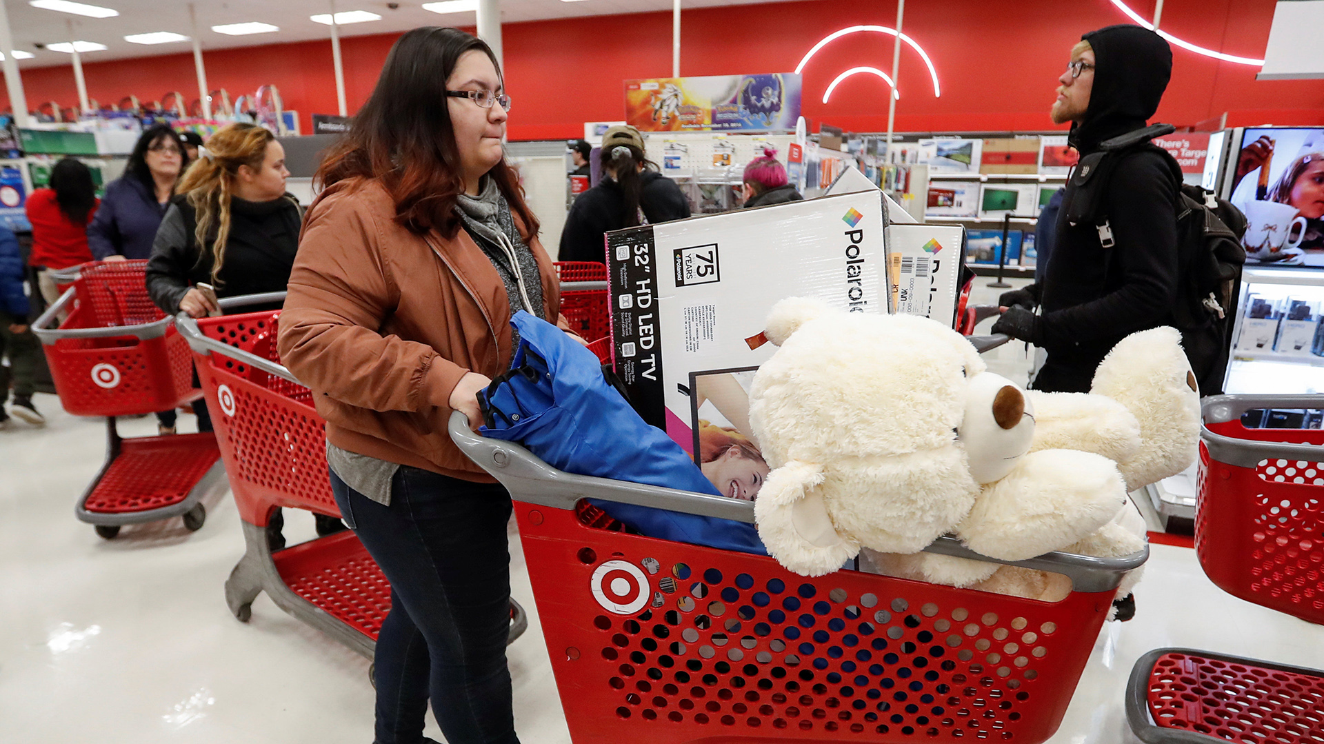 Customer pushes her shopping cart during the Black Friday sales event on Thanksgiving Day at Target in Chicago