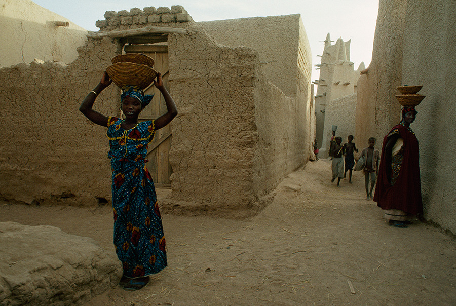 Women carry baskets