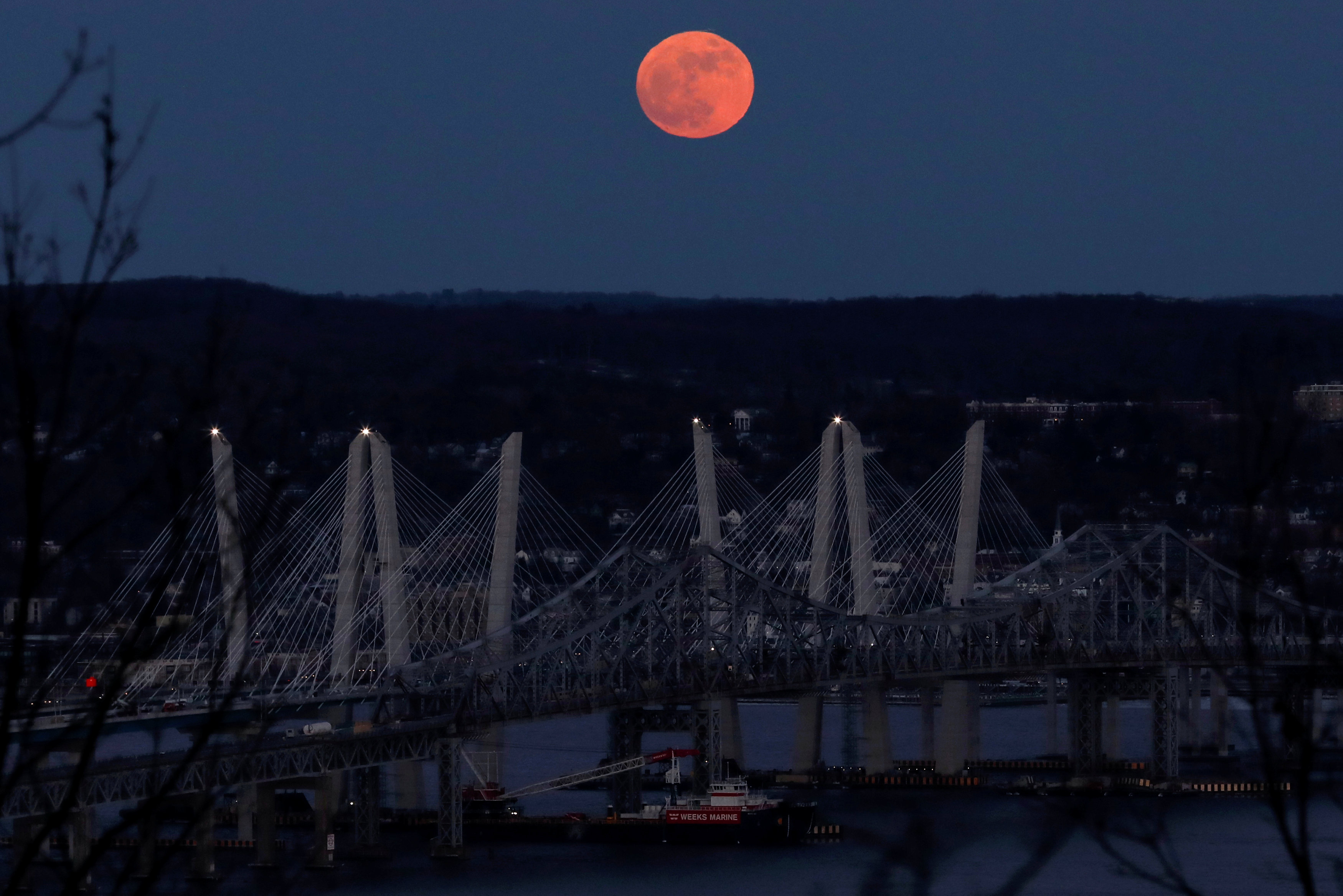 A 'supermoon' full moon is seen above the Hudson River and the Mario M. Cuomo Bridge from Nyac