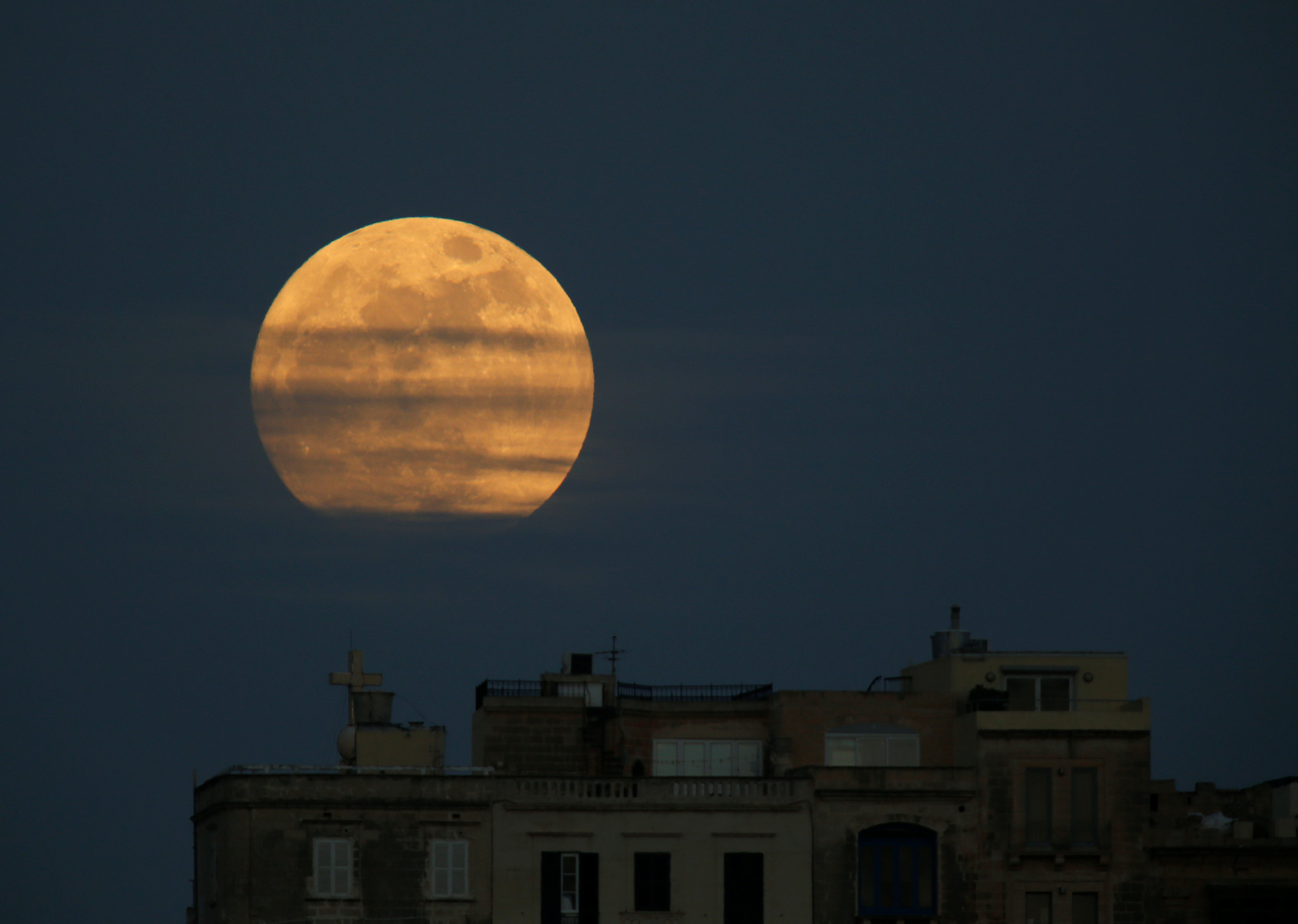 A 'supermoon' full moon is seen rising in Pieta