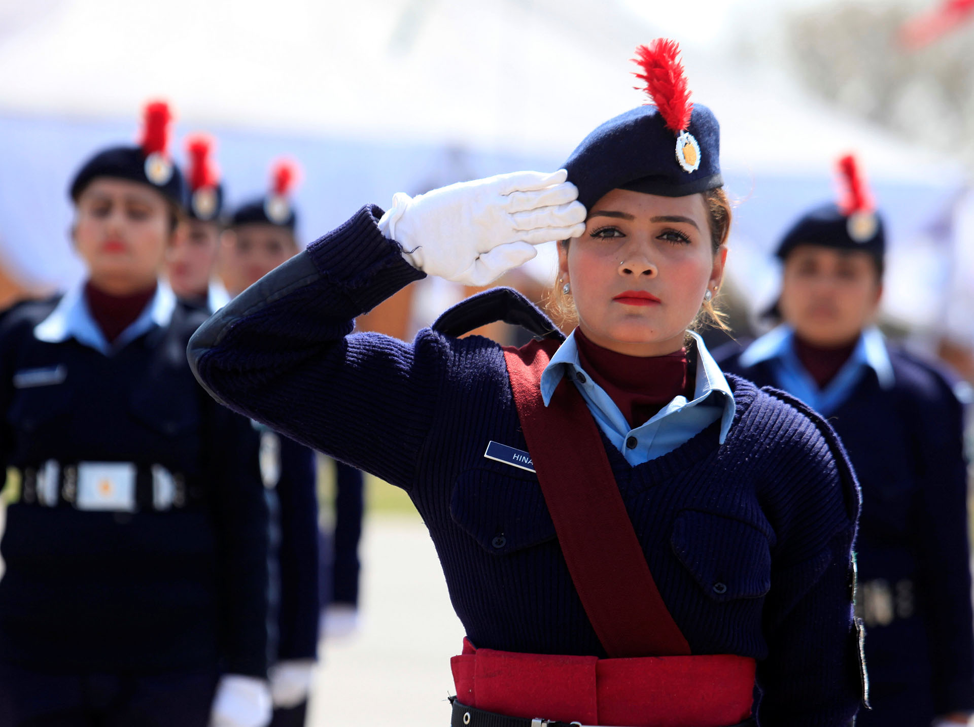 Female members of police forces take part in a ceremony on International Women's Day, at the police headquarters in Islamabad
