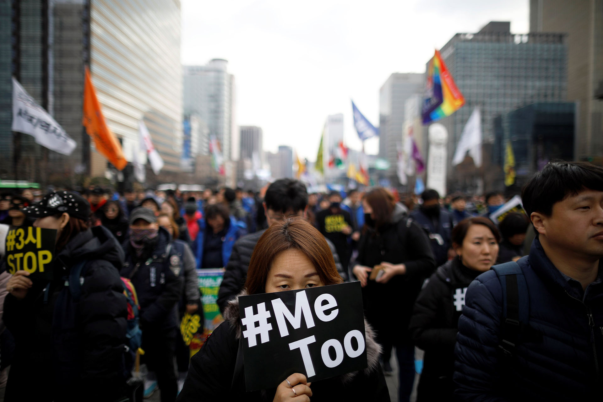People attend a protest as a part of the #MeToo movement on the International Women's Day in Seoul