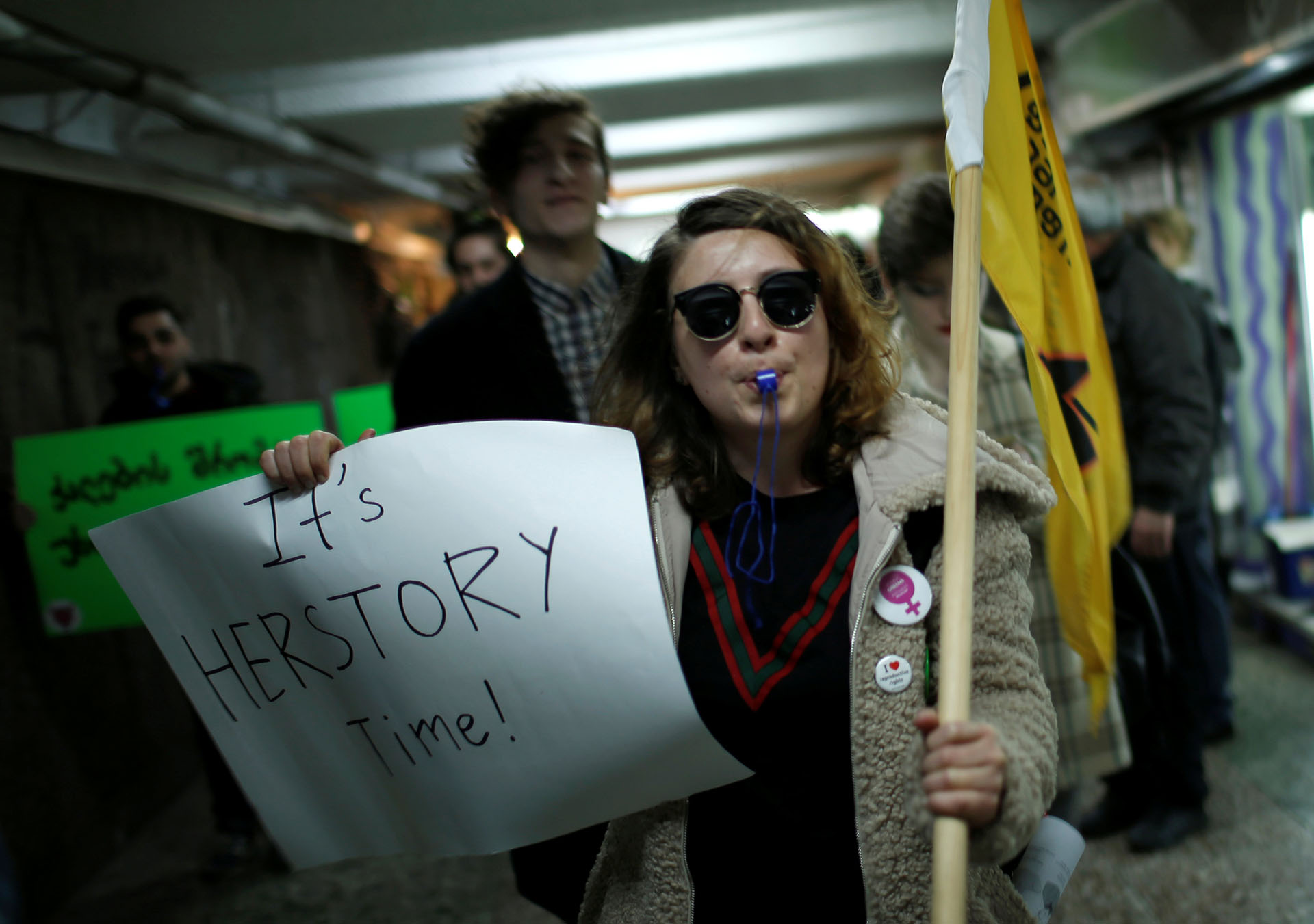 Women's right activists march on the street on the International Women's Day in Tbilisi