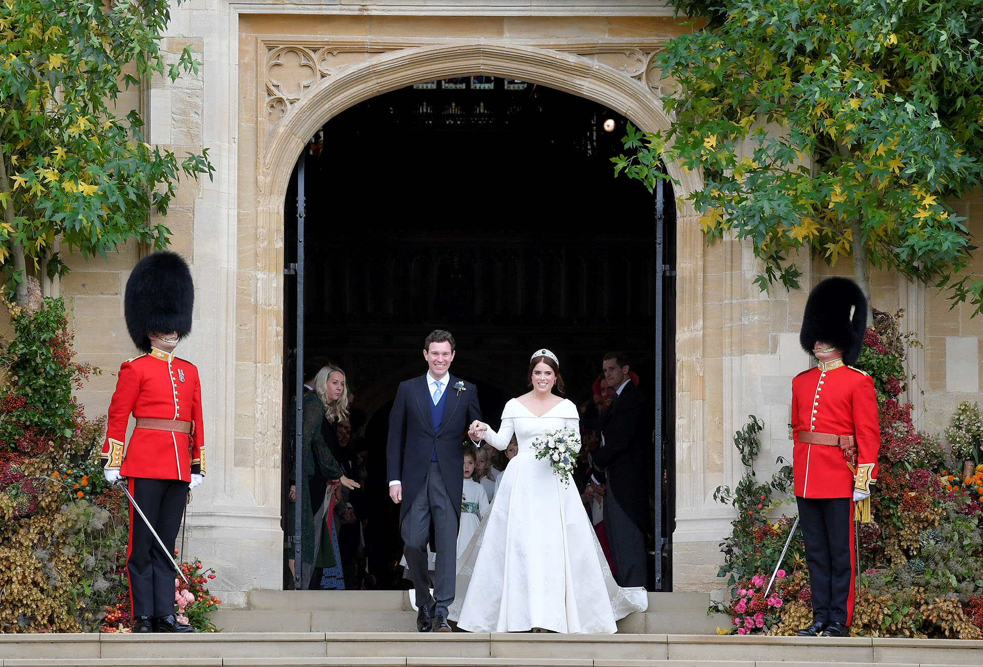 Britain's Princess Eugenie of York and her husband Jack Brooksbank leave after their wedding at St George's Chapel in Windsor Castle, Windsor