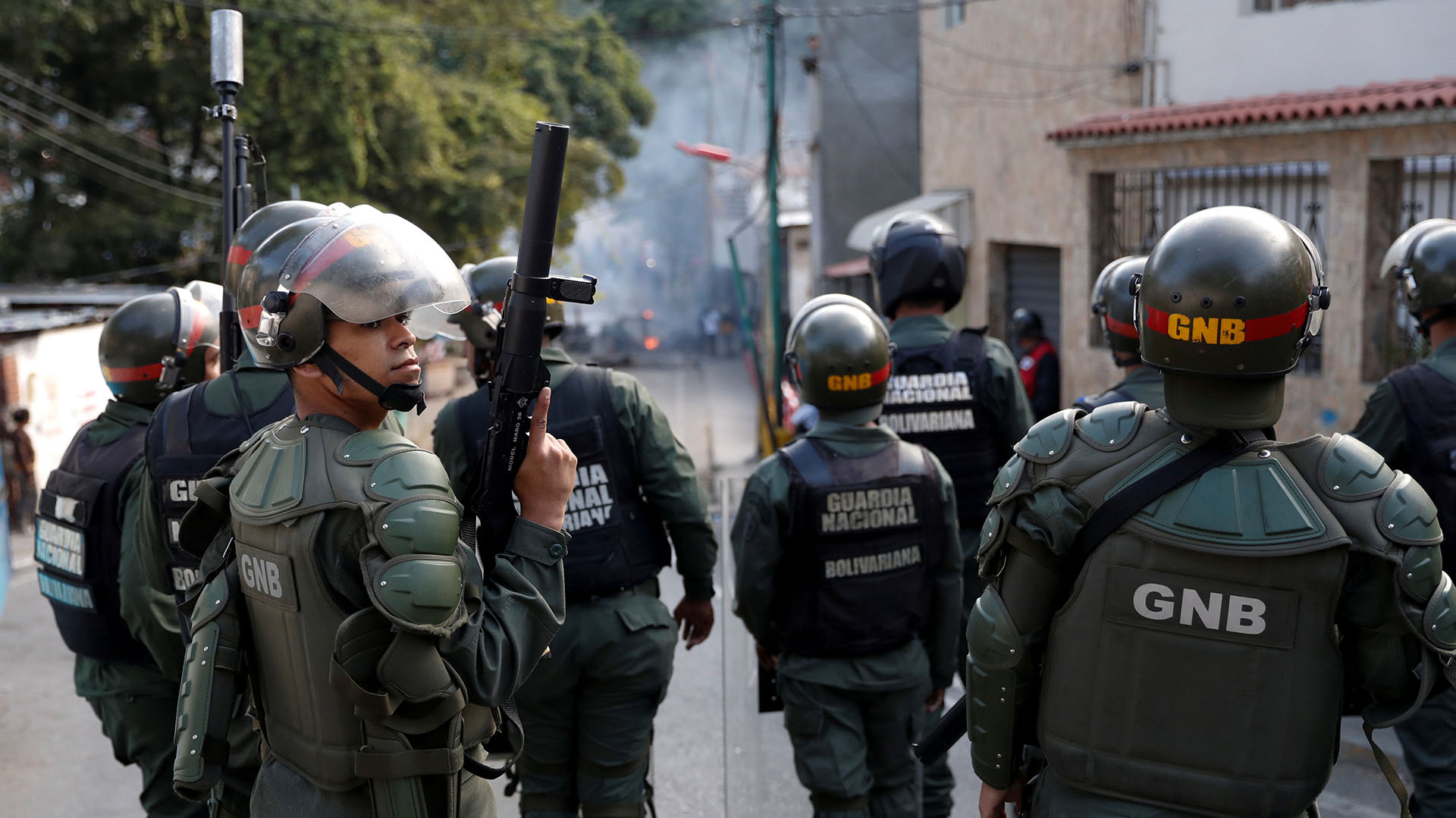 FILE PHOTO: Venezuelan National Guards are seen as demonstrators protest close to one of their outposts in Caracas