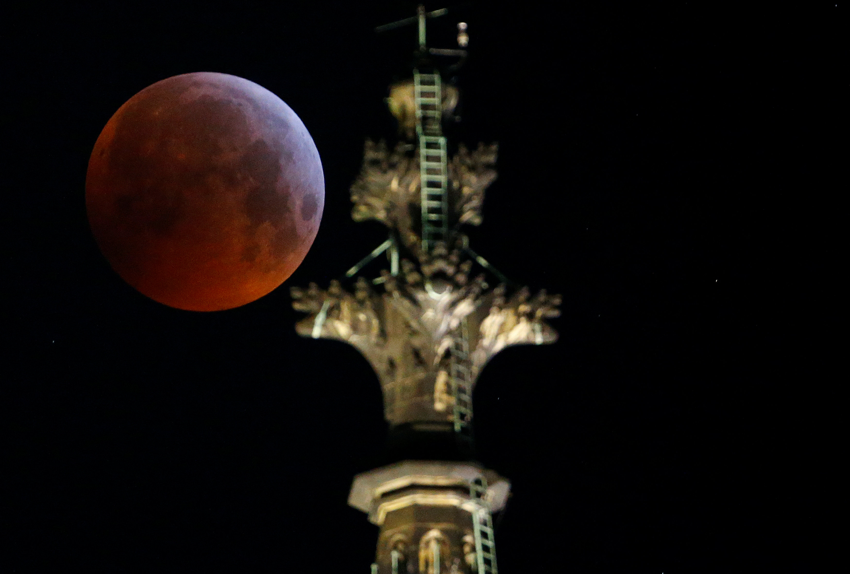 "The ""super blood wolf moon"" is seen during a total lunar eclipse behind the gothic cathedral in Cologne"