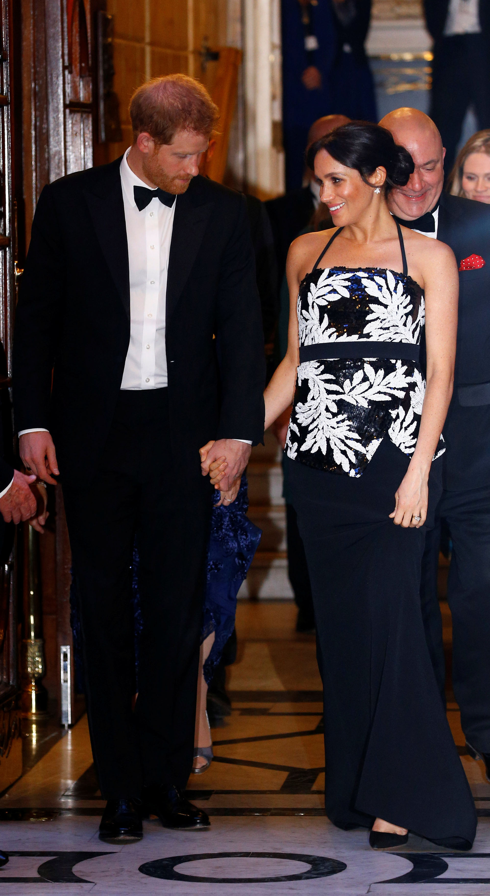 Britain's Prince Harry and Meghan, the Duchess of Sussex, leave after the Royal Variety Performance in London