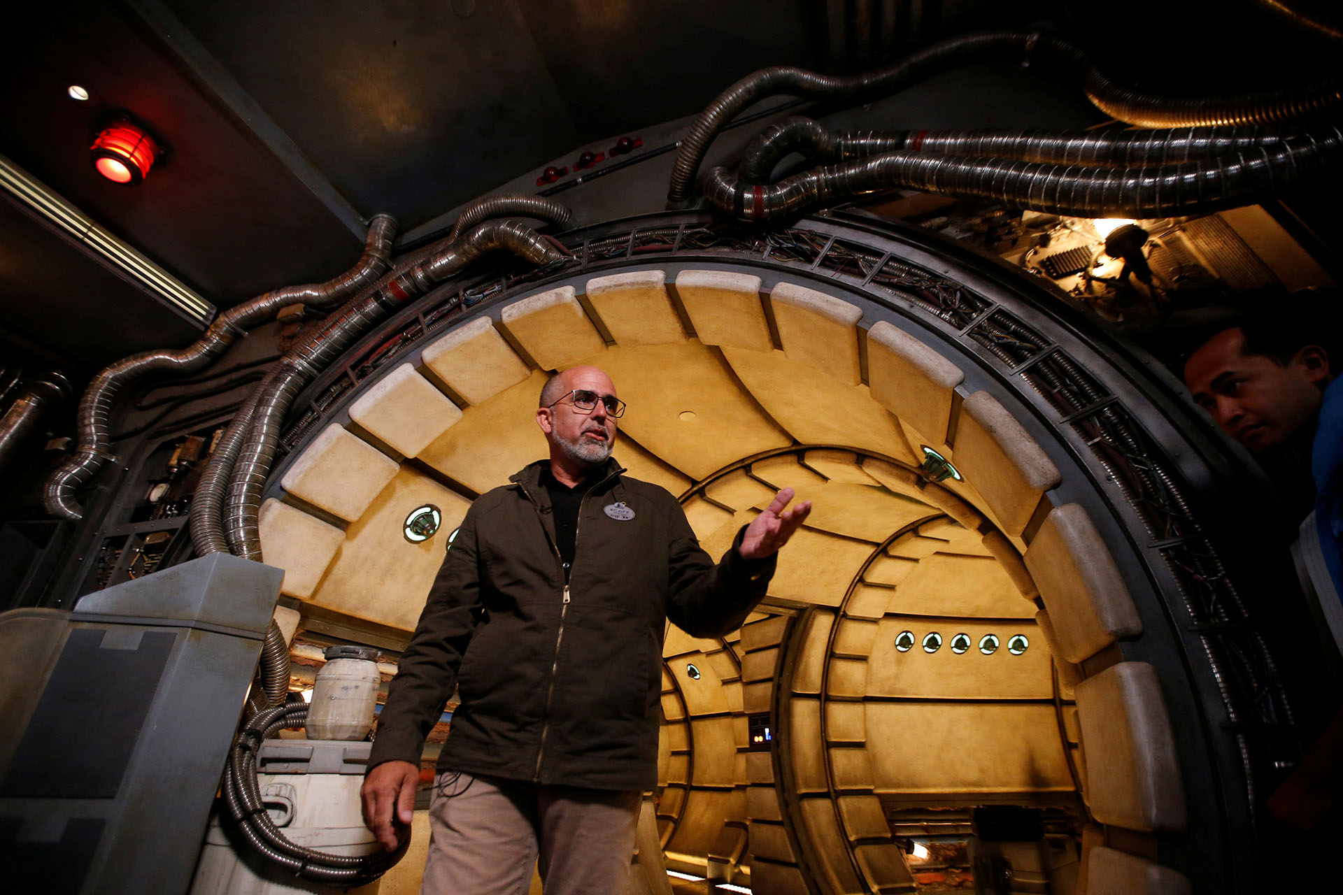 "Mallwitz, Executive Creative Director at Walt Disney Imagineering, walks through the Millennium Falcon deck at ""Star Wars: Galaxy's Edge"" during a media preview event at Disneyland Park in Anaheim"