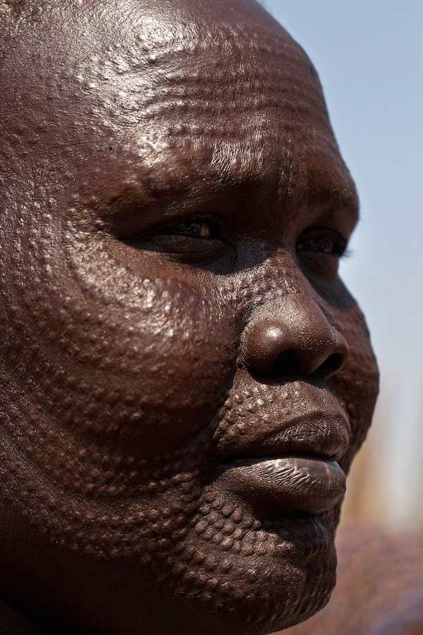 A southern Sudanese woman waits for food