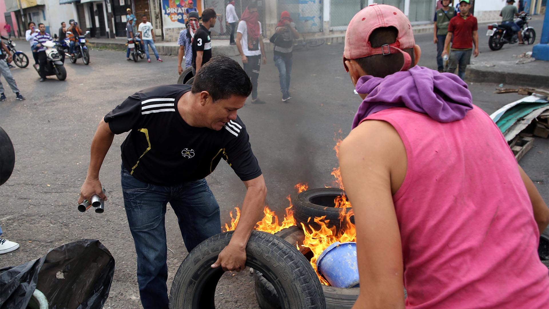 Demonstrators build barricades while clashing with Venezuela's security forces in Urena