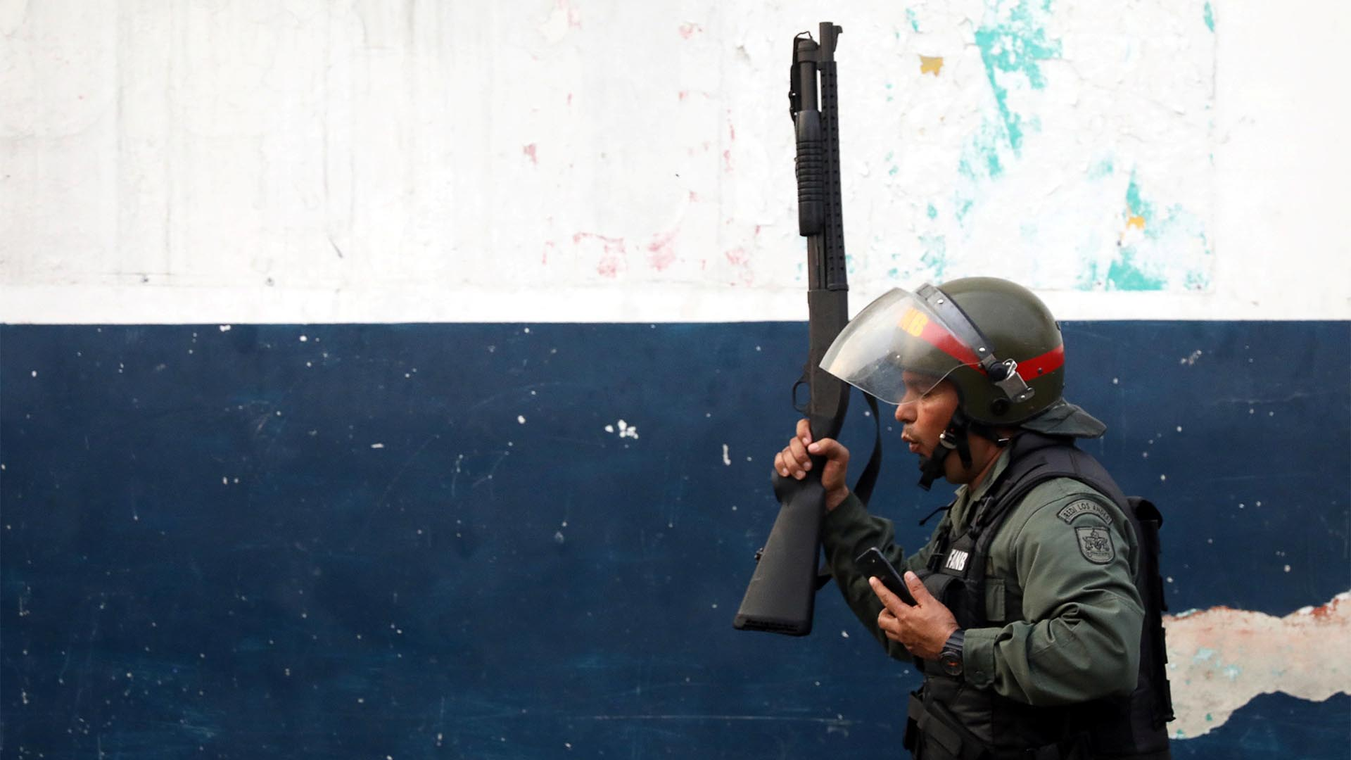 A member of Venezuela's security forces looks on while clashing with activists in Udena
