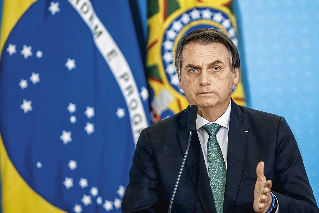 Brazil's President Jair Bolsonaro speaks during a ceremony to launch the new worker fund stimulus at the Planalto Palace in Brasilia