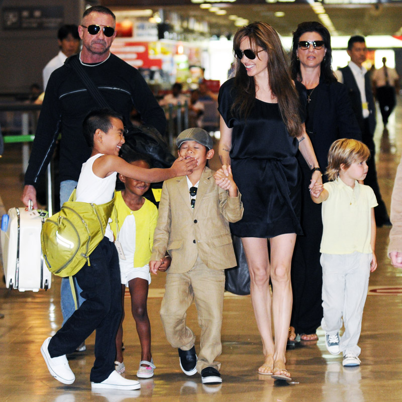 Angelina Jolie tells off Maddox for playing rough with Pax at the airport in Japan. (Set 3)