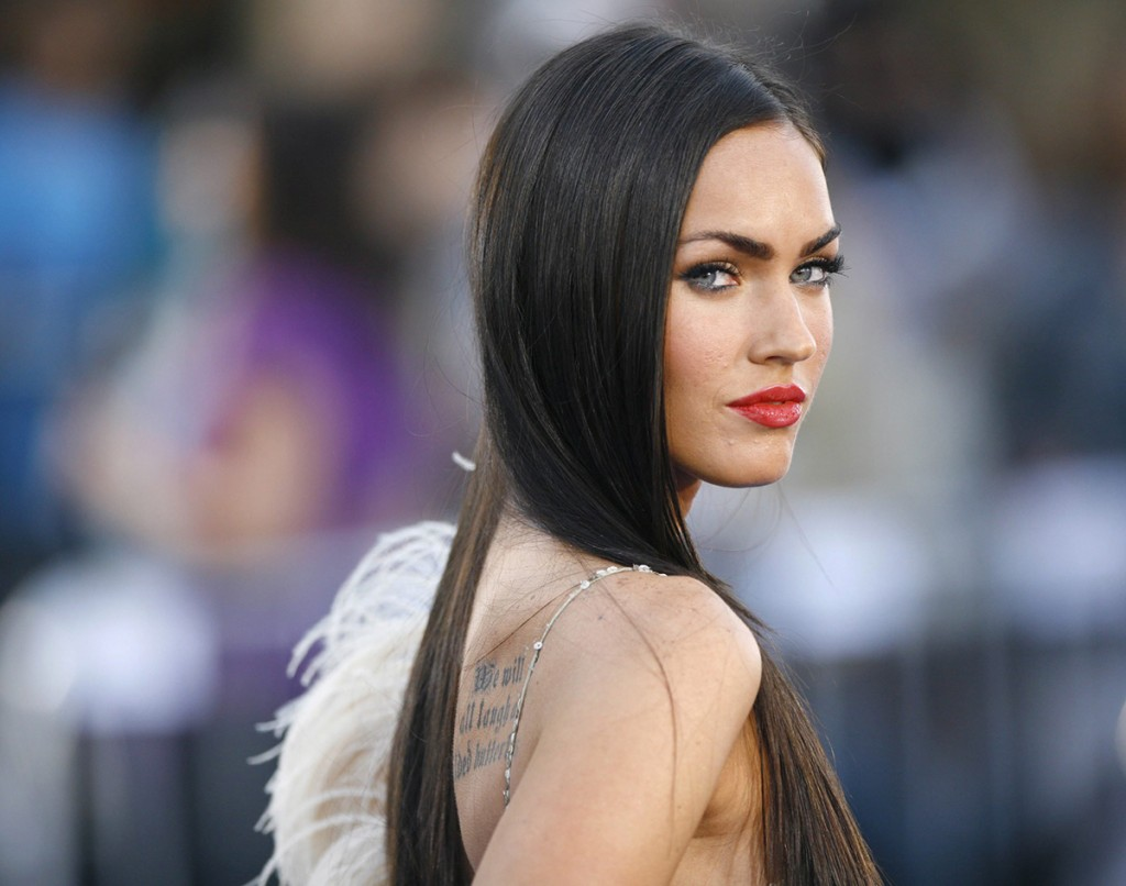 Megan Fox poses at the premiere of Transformers at the Mann's Village theatre in Los Angeles