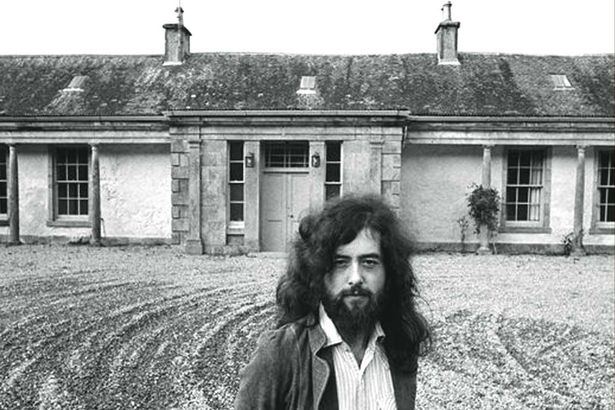 PAY-Jimmy-Page-in-front-of-Boleskine-House (1)